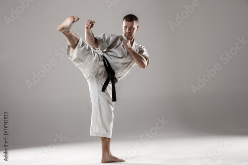 Man in white kimono training karate Wallpaper Mural