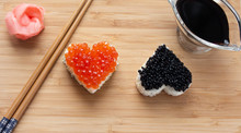 Two Heart Shaped Sushi With Sa...