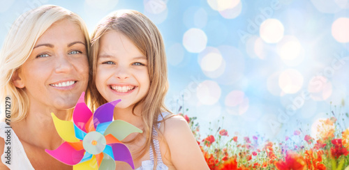 Fotografia, Obraz  happy mother and little girl with pinwheel toy