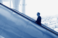 Indian Businessman Going Up Es...