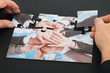 Person Hand Holding Jigsaw Puzzle
