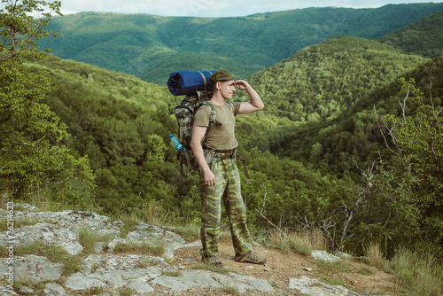 Young man hiking smiling happy portrait.
