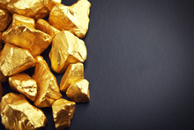 Gold Nuggets On A Black Background. Closeup