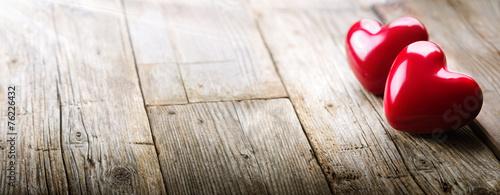 Fototapeta rays of sunlight on hearts in love obraz