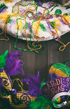 Mardi Gras: King Cake With Party Mask, Hat And Tiara