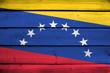 Venezuela Flag on wood background