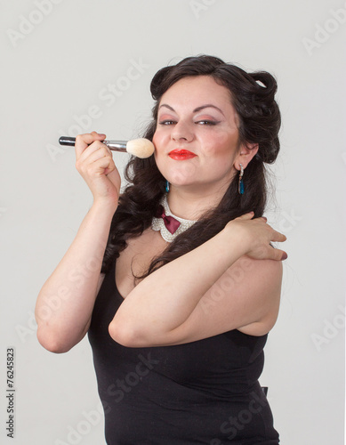 Photo  Pretty brunette girl posing like Marilyn Monroe with red lips