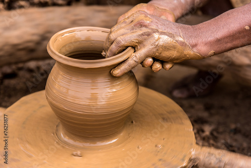 Potter making earthen pot