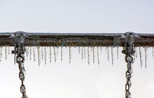 Close Up Of Ice Covered Swing ...