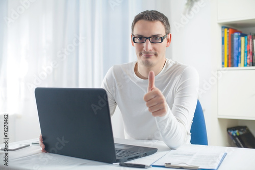 Garden Poster Young man using laptop showing ok sign