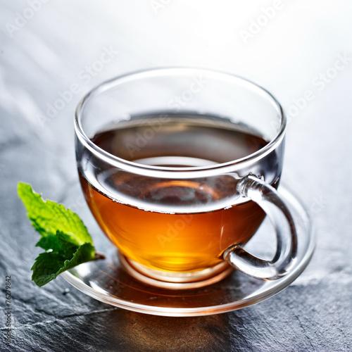 Tea glass of hot tea with mint garnish