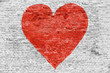 Leinwandbild Motiv Symbol of love painted on brick wall