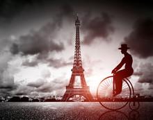 Man On Retro Bicycle Next To Effel Tower, Paris, France.
