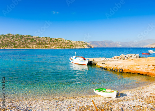 Old fishing boats by the sea in Amorgos island in Greece Wallpaper Mural