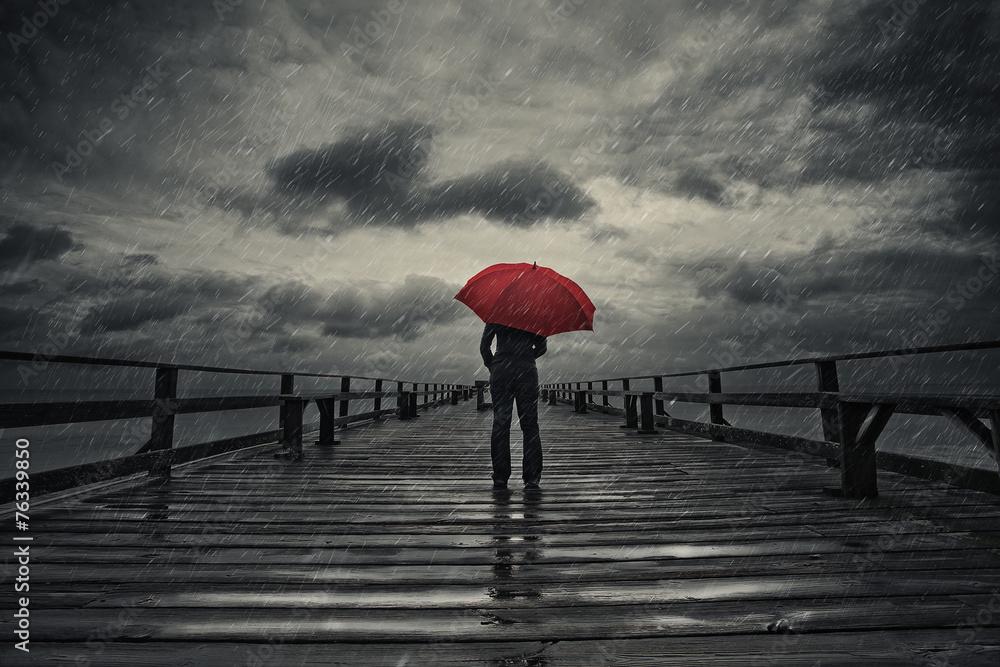 Fototapeta Red umbrella in storm