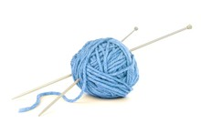 Ball Of Blue Yarn With Knitting Needles Isolated On White