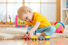 Child Boy Playing With Toys In...
