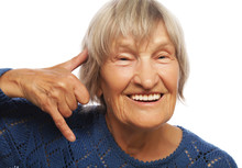 Senior Happy Woman Is Making A Call Me Gesture