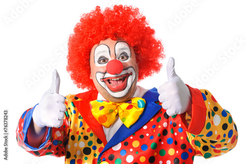 Valokuvatapetti Portrait of a smiling clown giving thumbs up isolated on white