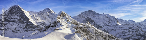 Foto auf Gartenposter Alpen Four alpine peaks and skiing resort in swiss alps