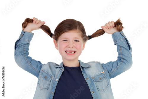 Photo Funny little girl toothless pulling her pigtails