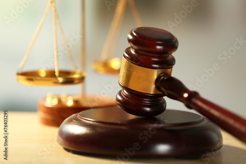 Fotografering  Wooden judges gavel on wooden table, close up