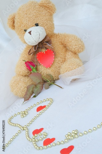 White teddy bears with hearts and roses
