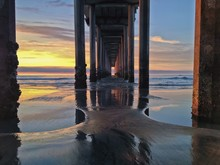 Underneath Beach Pier At Sunset With Colorful Sky, La Jolla, CA