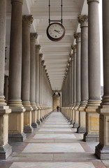 FototapetaClassical style colonnade with Clock, Karlovy Vary