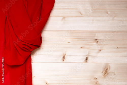 Fotografie, Obraz  Red textile on wooden wall