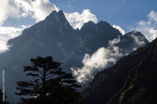 Peaks of mountain tops in the Himalayas in Nepal плакат
