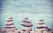 Vintage retro hipster style image of stones on beach, Zen spa co
