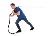 Portrait Of A Man Pulling Rope