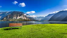 Wooden Bench Near The Lake Between By Mountains