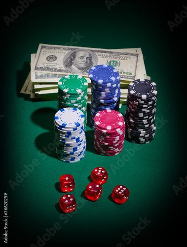 Stack of dollars dices and chips плакат