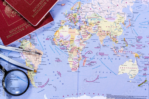 In de dag Wereldkaart open world map with magnifying glass, compasses and passport
