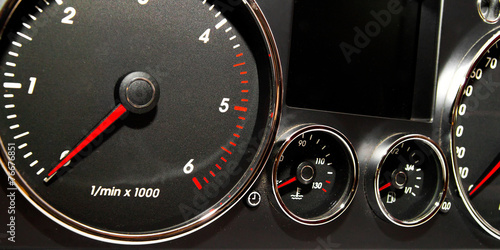 Photo  Speedometer, tachometer and fuel gauge set with chrome bezel