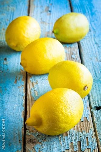 Fresh juicy lemons on a blue background