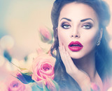 Retro woman portrait in pink roses. Vintage styled portrait