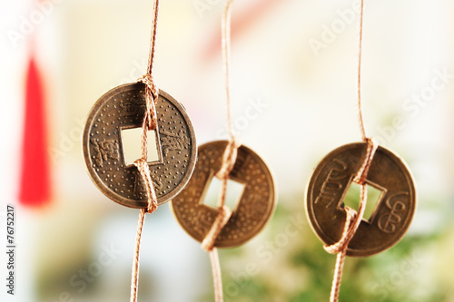 Photo  Feng shui coins on light background