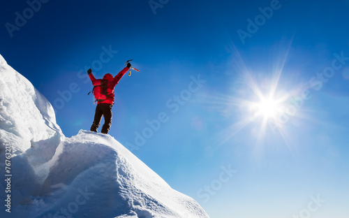 Photo Stands Mountaineering Mountaineer celebrates the conquest of the summit.