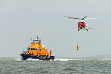 Orange Sea Rescue Boat With Re...