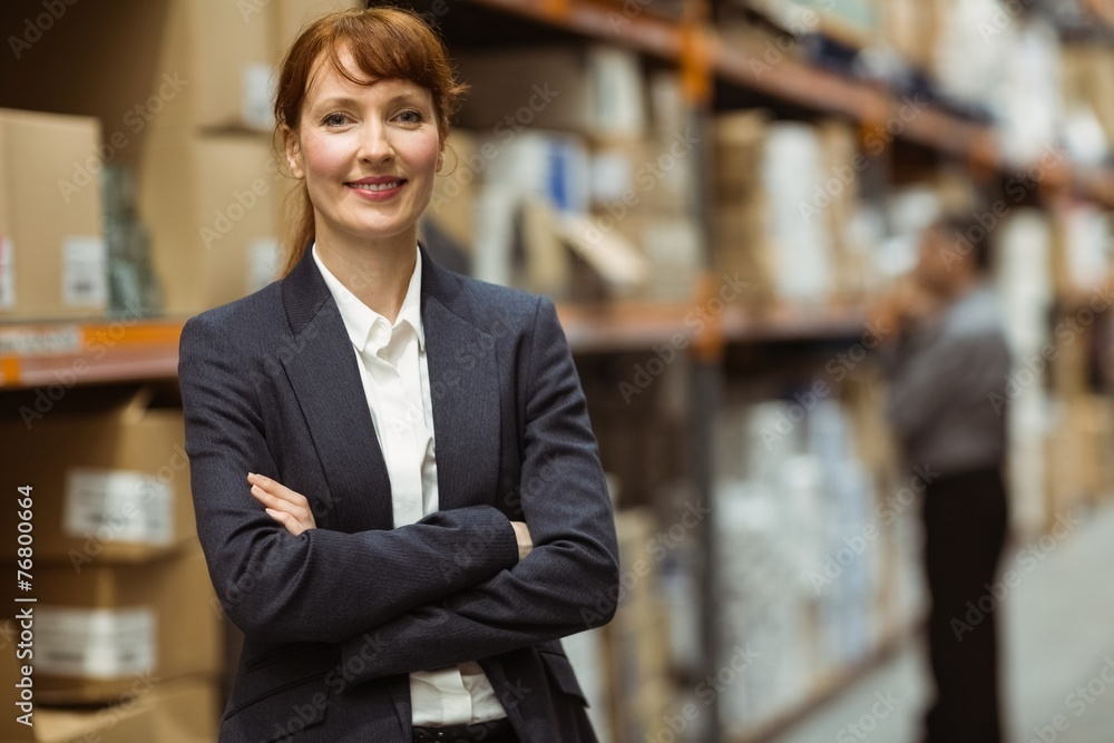 Fototapeta Female manager with arms crossed