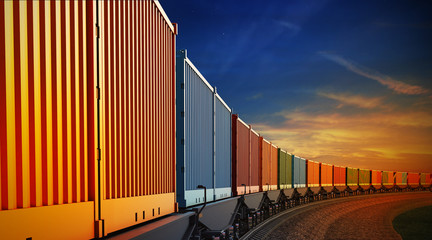 Fototapeta wagon of freight train with containers on the sky background