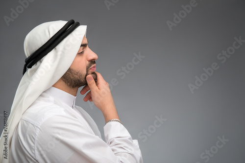 Fotografie, Tablou Arab man thinking hard with hand on his face