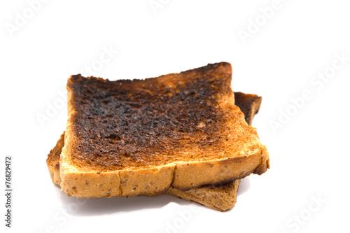 Burnt toast slice isolated on white background