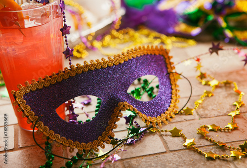 Mardi Gras: Party Mask Sits Against Tropical Hurricane Cocktail Poster