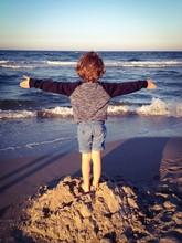 Child Enjoying The Fresh Sea Air