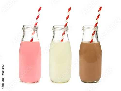 Photo Stands Milkshake Strawberry regular and chocolate milk in bottles isolated