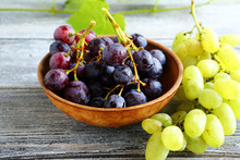Bunches Of Grapes In Bowl On W...